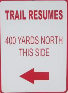Trail-resumes-sign-Prairie-Spirit-Trail-Ottawa-to-Iola-KS-6-3-2016