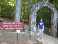 Sandra-Schmid-in-front-of-AT-sign-Amicalola-Falls-SP-GA-10-22-2008