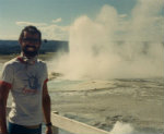 Jim-Schmid-next-to-geyser-Yellowstone-NP-AYH-Cross-Country-Bike-Trip-1987